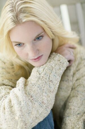 spectating: High angle view of young woman wearing sweater