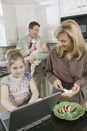 spectating: Family in kitchen at breakfast time