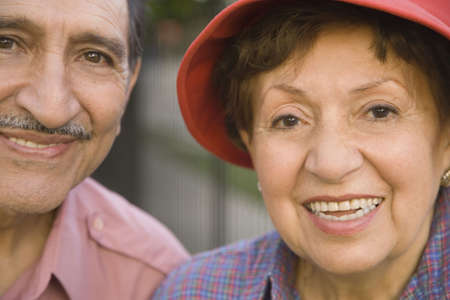 lass: Close up of senior Hispanic couple smiling outdoors