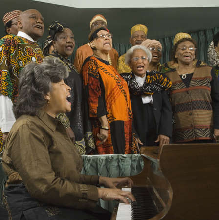 milepost: Group of middle-aged African people singing