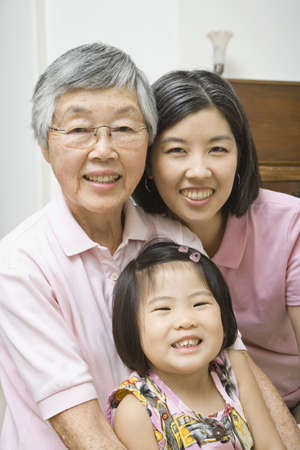 gramma: Asian grandmother with daughter and granddaughter smiling