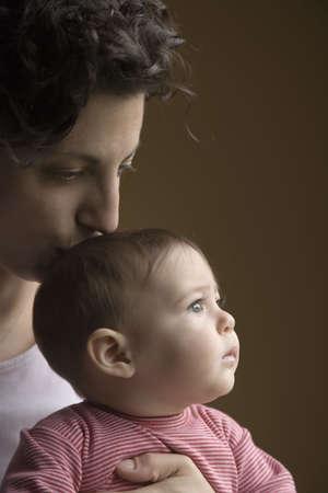 babyboomer: Mother kissing babys head LANG_EVOIMAGES