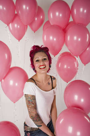 '' studio shot '': Studio shot of woman surrounded by balloons LANG_EVOIMAGES