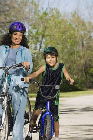 babyboomer: Hispanic mother and son riding bicycles