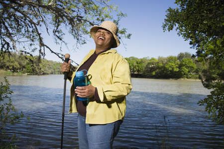 fathering: African woman hiking next to water