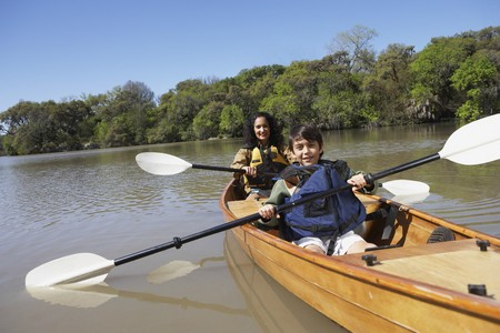 profile picture: Hispanic mother and son paddling canoe