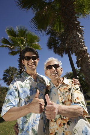 poppa: Father and adult son giving thumbs up outdoors