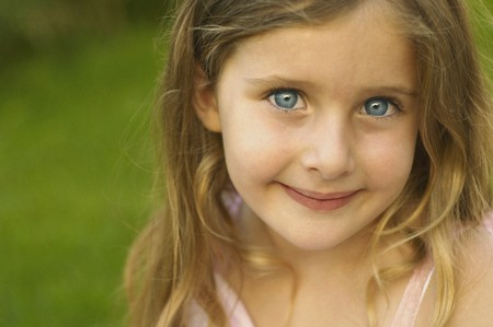 solicitous: Close up of young girl smiling