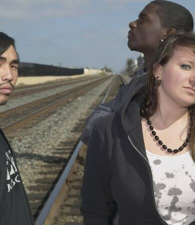 north western european descent: Group of young adults standing on railroad tracks