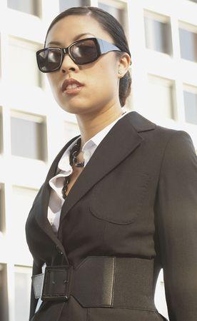 north western european descent: Asian businesswoman wearing sunglasses outdoors