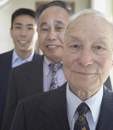 ninetys: Senior Asian man with family members in background