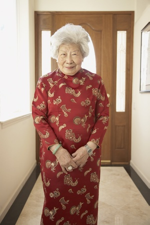 ninety's: Senior Asian woman in traditional dress smiling LANG_EVOIMAGES