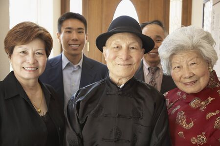 Multi-generational Asian family smiling