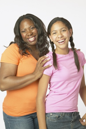 silliness: Studio shot of African mother and daughter smiling