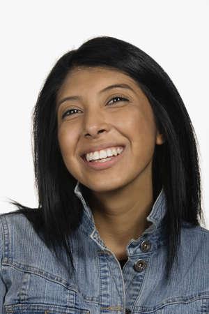 unsatisfied: Close up studio shot of Hispanic woman smiling