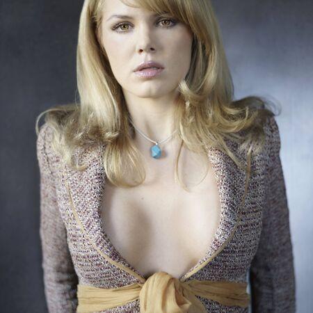 Woman posing with revealing shirt