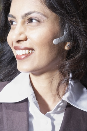 Close up of Indian businesswoman using headset Stock Photo