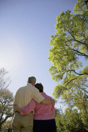 gramma: Rear view of couple hugging outdoors
