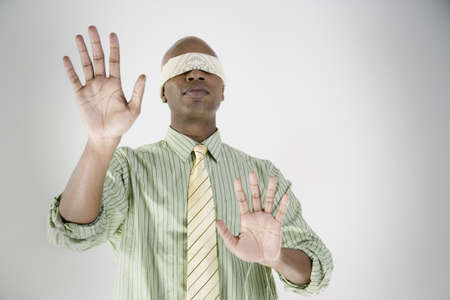 blindfolded: African businessman blindfolded with hands out