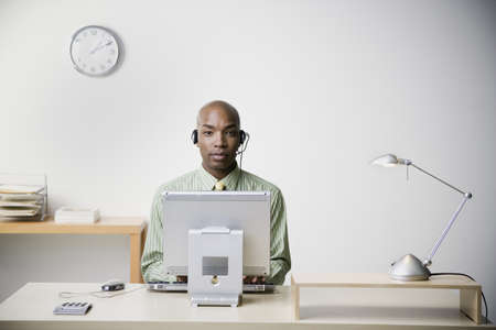 jesting: African businessman working at desk