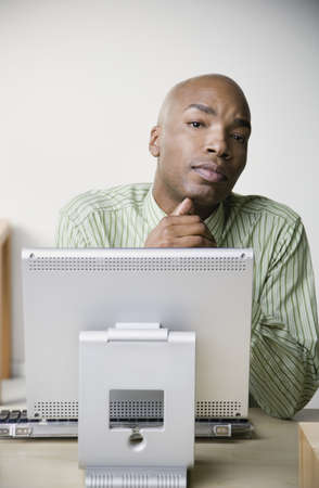 jesting: African businessman sitting at desk
