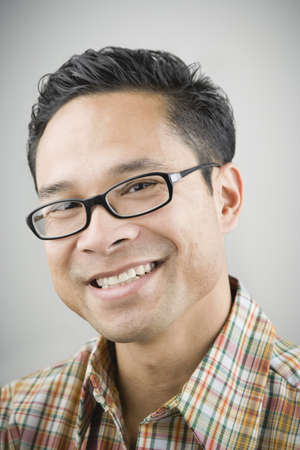 black business man: Close up of Asian man wearing eyeglasses and smiling