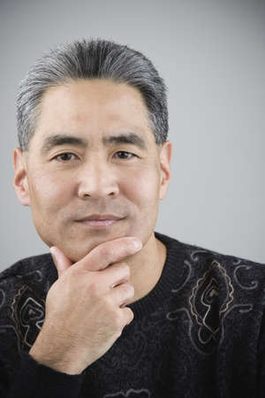 portraiture: Asian man with hand on chin