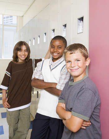shopping buddies: Boys smiling and leaning on school lockers LANG_EVOIMAGES