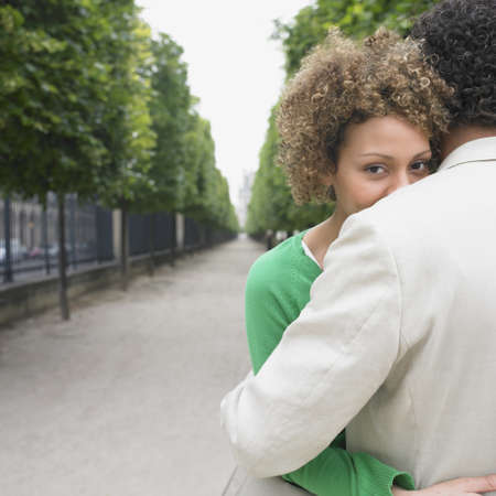 finding a mate: African couple hugging in park