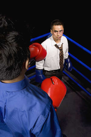 jeopardizing: Two businessmen in boxing ring