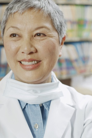 attentiveness: Close up of senior Asian female dentist smiling