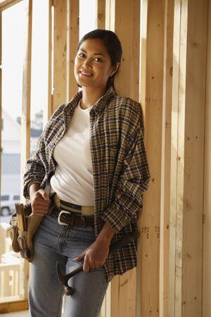 female construction worker: Asian female construction worker inside construction site