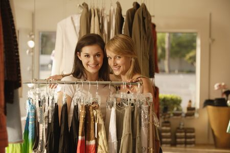 shopping buddies: Two women shopping at clothing store
