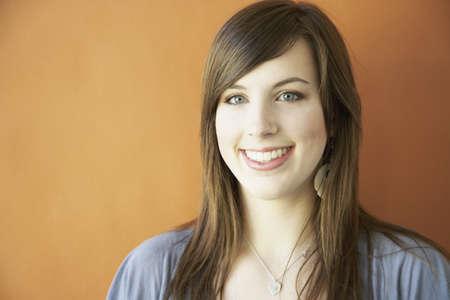 teenaged girl: Studio shot of teenaged girl smiling