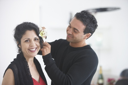longshot: Man putting flower in womans hair