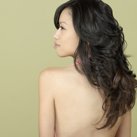 finding a mate: Studio shot of Asian woman with bare back LANG_EVOIMAGES