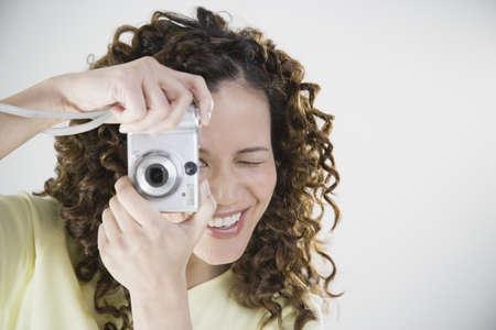 unyielding: Asian woman using digital camera
