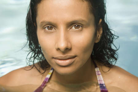 three persons only: Close up of Indian woman in swimming pool LANG_EVOIMAGES
