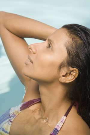casualness: Close up of Indian woman in swimming pool LANG_EVOIMAGES