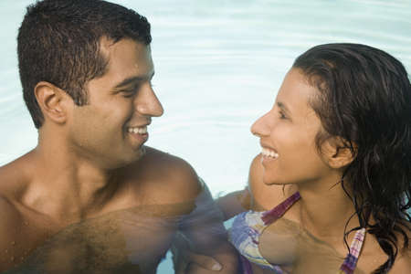 casualness: Indian couple in swimming pool LANG_EVOIMAGES