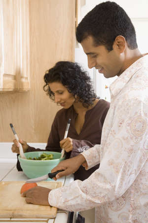 indian ethnicity: Indian couple preparing food in kitchen