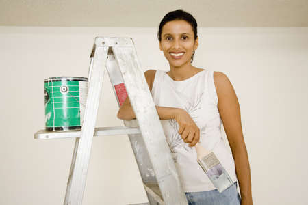 shopping buddies: Portrait of Indian woman with painting supplies