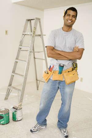 profile measurement: Portrait of Indian man wearing tool belt LANG_EVOIMAGES