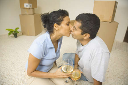 dangling: Indian couple kissing in new house
