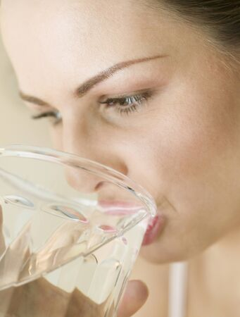 Hungarian woman drinking glass of water
