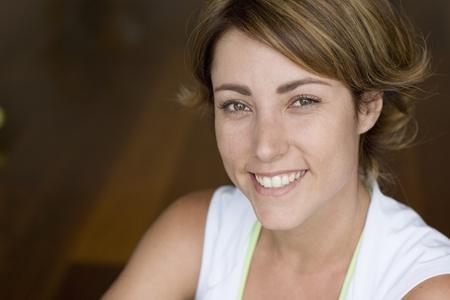 exerting: Close up of Hispanic woman smiling