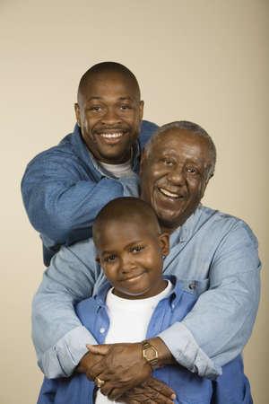 bathtowel: Portrait of multi-generational African male family members LANG_EVOIMAGES
