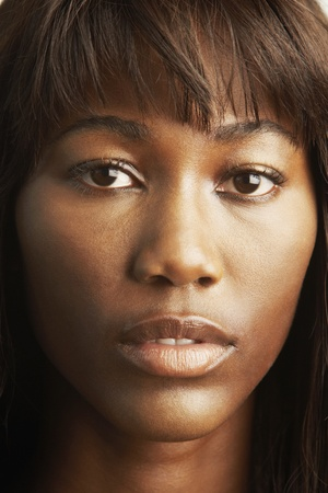 adventuresome: Close up of African woman's face LANG_EVOIMAGES