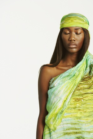 attired: Studio shot of African woman with eyes closed LANG_EVOIMAGES