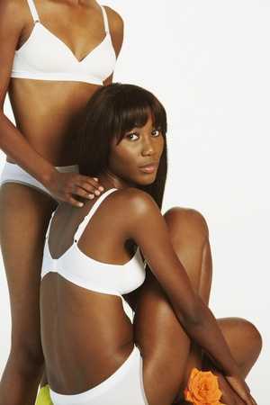 african american woman silhouette: Two African women wearing underwear LANG_EVOIMAGES